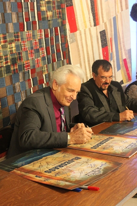 Del McCoury signing commemoratove poster, photo - Brad Hardisty